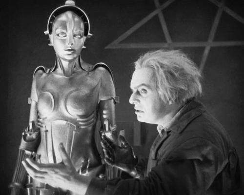 In Fritz Lang's expressionist sci-fi epic, 'false Maria' is the robot double of the peasant girl prophet in Berlin 2026. She unleashes chaos among the city's workers and is ultimately burned at the stake as a witch. She is the first robot depicted on film. The machine-character inspired the art deco look of C-3PO in Star Wars.   (Source: metropolis1927.com)