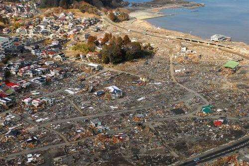 An aerial view of damage to Sukuiso, Japan, taken one week after the earthquake and tsunami devestated the area in March, 2011. Photo courtesy: Dylan McCord. U.S. Navy