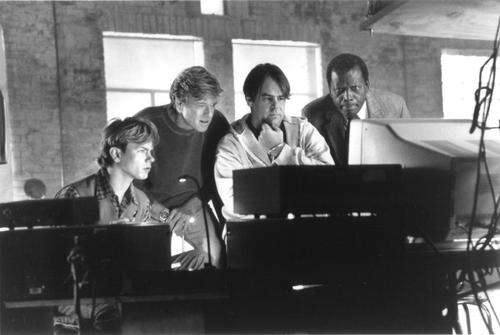 Caption: Still of Dan Aykroyd, River Phoenix, Robert Redford and Sidney Poitier in Sneakers (1992) Source: IMDb