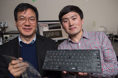 Georgia Tech Professor Zhong Lin Wang (left) and doctoral candidate Jun Chen with their new self-powered keyboard. (Source: Georgia Tech)