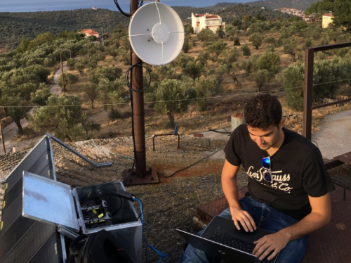 A volunteer sets up a satellite dish at a refugee camp in Lesbos, Greece. (Images: Disaster Tech Lab)