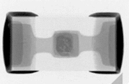 AnX-ray image of a GiGuard diode as seen from above, depicting the symmetry and accuracy of overlapping electrodes in small 0201 package.